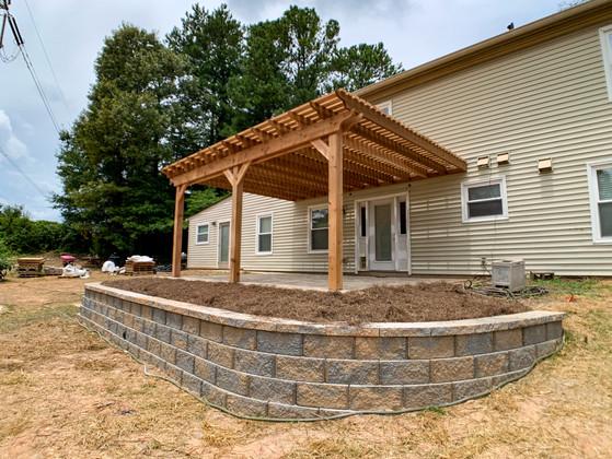 """Cedar pergola with 2""""x4"""" shade slatson a paver patio"""
