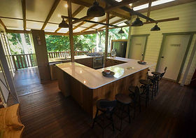 A kitchen with spacious benchtops that is convivial and so convenient for your special event or friends gathering.