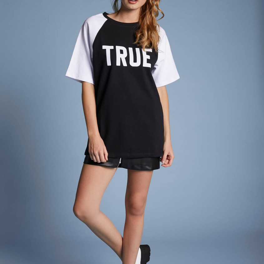 Stay True To You. Oversized raglan unisex tee with the word TRUE printed in the front and the word IMG on the back (words printed on flocking material). Men's standard sizing. Fabric: 100 cotton  True Img  By Vanessa Merrell & Veronica Merrell