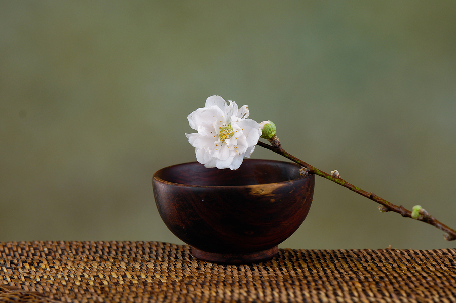 bigstock-cherry-flower-with-bowl-on-mat-44736274.jpg