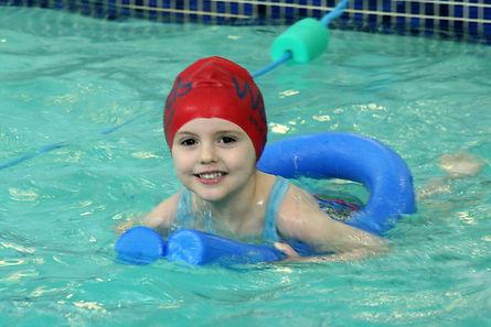Children enjoying swimming lessons