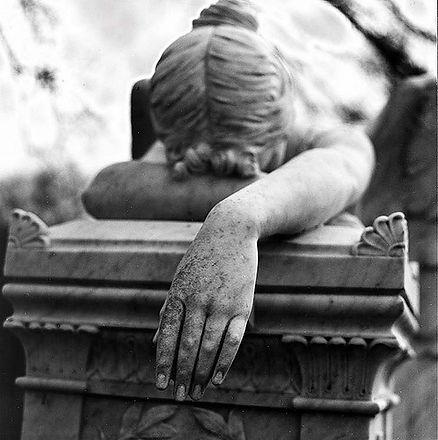 Grief-woman-on-casket-21.jpg