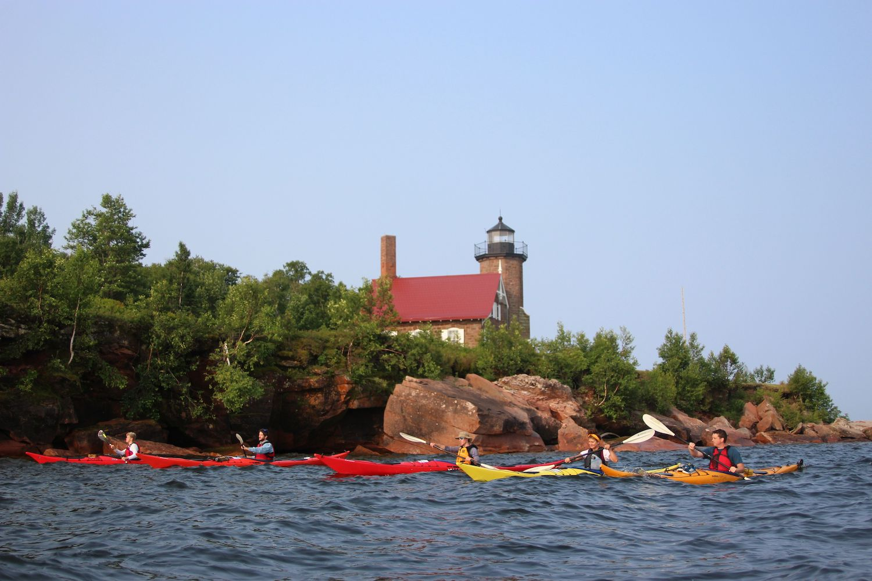Kayaking around a lighthouse