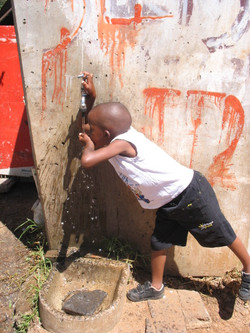 Boy at Water faucet