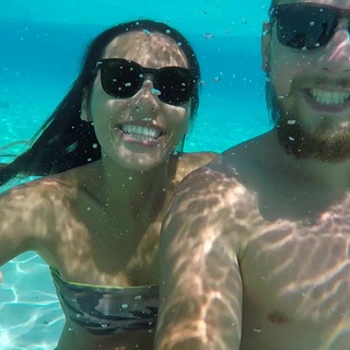 Young Happy Couple in Sunglasses Making Funny Underwater Selfie with GoPro Camera. HD Slow Motion. Thailand..mov