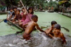 © Ekaterina Savtsova | Children Playing on a Makeshift Boat in Indonesia