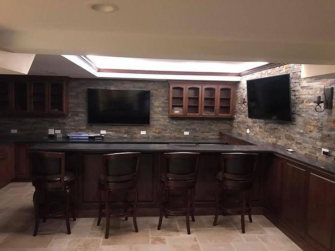 Tuscan basement bar cabinets backsplash