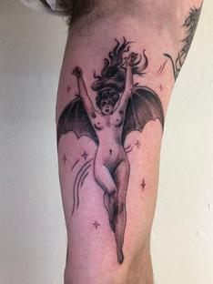 Bat woman tattoo