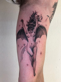 Bat woman tattoo