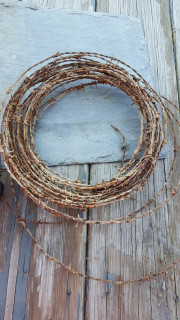 repurposed barn siding wood, barbed wire wreath