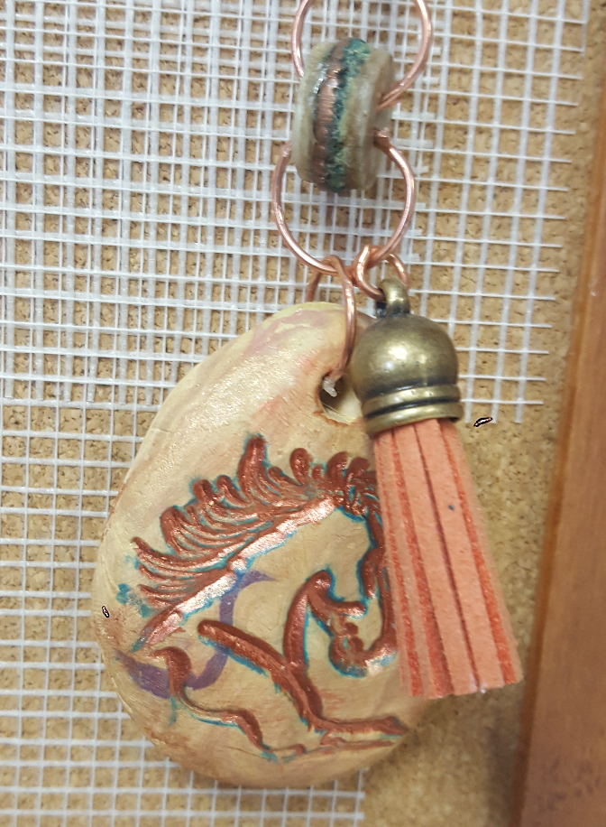 clay horse pendant with tassle
