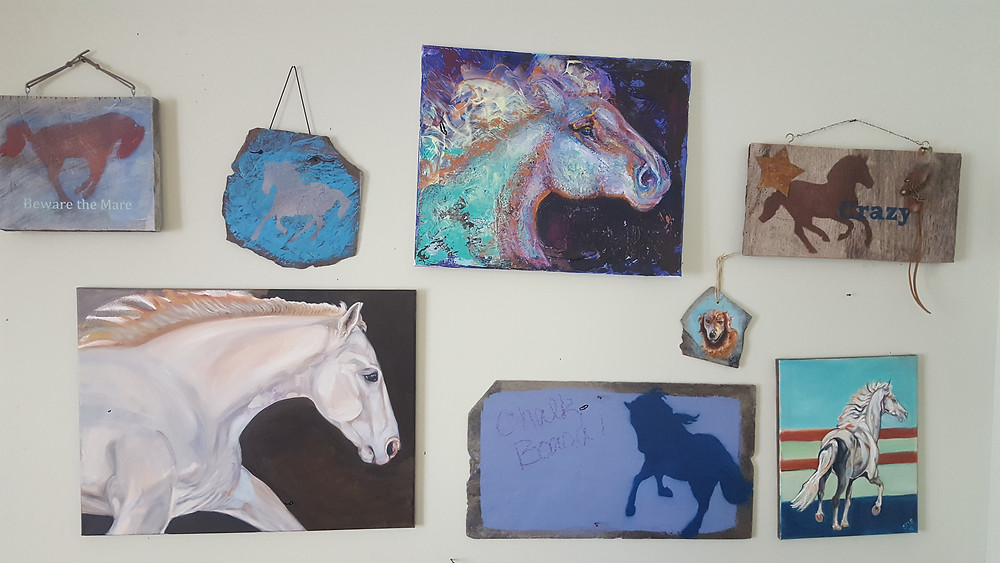 art studio photo of horse paintings