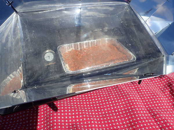 Baking the carrot cake in the solar oven