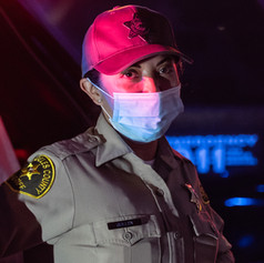 "Officer Guillen waits at a traffic checkpoint at the intersection of North Spring and Temple as she and other LA County Sheriffs wait for ""Jackie Lacey has got to go"" protesters to disperse."