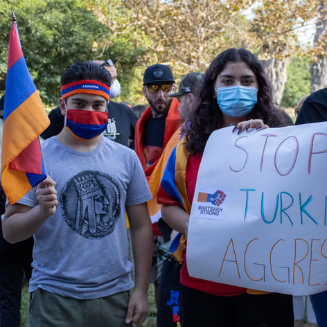 Granada High School students (L-R) Eduard Manucharyan, 14, and his friends Eva Gregoryona, 16, and Artur Sagradyan, 17, express their disagreement with the Azeri and Turkish aggression in Artsakh (Republic of Nagorno-Karabakh) on Sunday, Oct. 11, 2020.