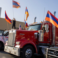 Trucks block main streets in Beverly Hills at the March for Victory on Sunday, Oct. 11, 2020.