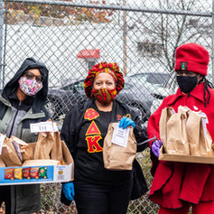 Three Middletown local volunteer women giving out food to voters outside Mulberry House in Middletown, NY on Monday, Oct. 26, 2020.