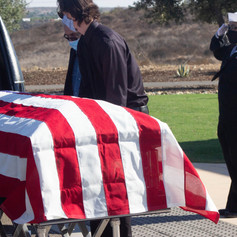 Former Navy captain Daniel Coughlin's casket being carried into a hearse to his final resting place. Miramar National Cemetary. San Diego, Calif. Oct. 28, 2020.
