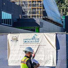 Valley Academic and Cultural Center's north-east corner is inspected by a construction worker on Campus Drive at Valley College, Nov. 2, 2020.