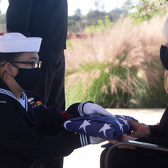 Former Navy captain Daniel Coughlin's widow receiving the folded America flag presented by honor gaurds. Miramar National Cemetary. San Diego, Calif. Oct. 28, 2020.