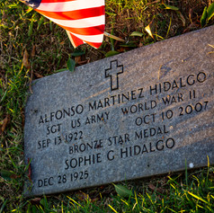 """Memorial grave-plaque of Alfonso Martinez Hidalgo indicates his service to the U.S. Army as a sergeant during World War II on Veterans Day, Nov. 11, 2020, in the San Fernando Mission Catholic Cemetery, on 11160 Stranwood Ave. in Mission Hills, Calif. Hidalgo's plaque indicates he was a recipient of a Bronze Star Medal. According to the National Archives, the Bronze Star Medal is awarded to veterans who distinguishes himself """"by heroic or meritorious achievement or service."""""""