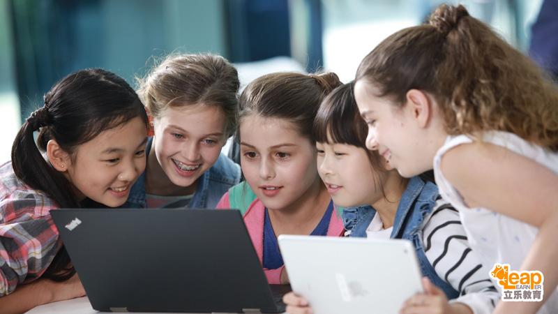 kids working as a team using laptop
