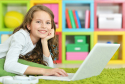 Teenage girl using a laptop