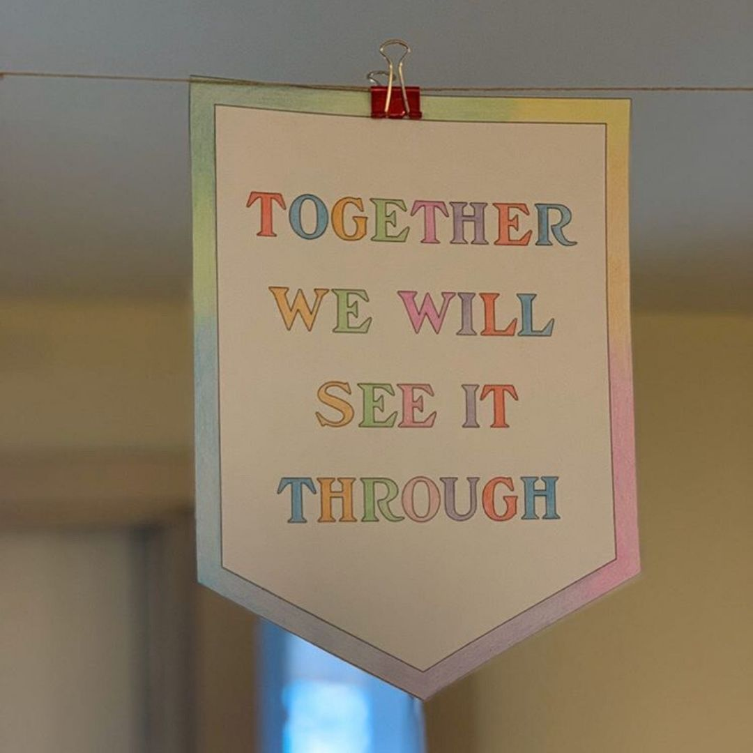 A banner that was coloured by a child in the shelter. These banners were hung up in our dining room for everyone to see.