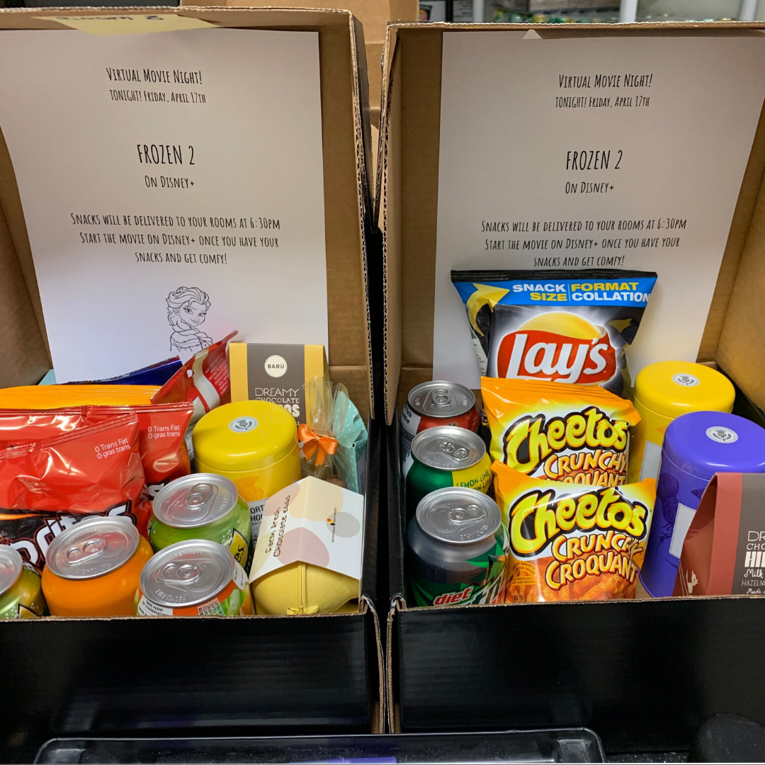 Snack boxes that were delivered to each family in their room for a physically distant movie night.