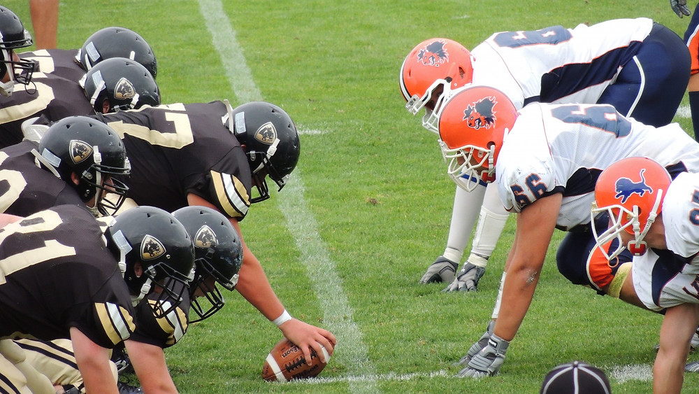 Two football teams square off.