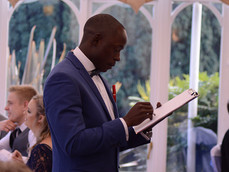 Michael drawing caricatures at a wedding