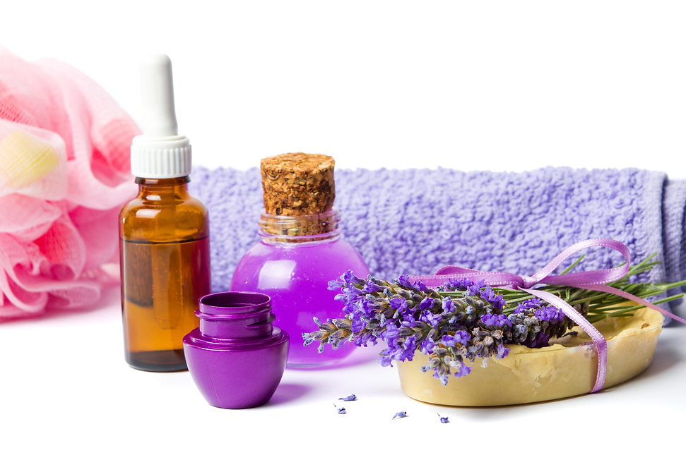Lavender oil and purple wellness set with flowers isolated.jpg