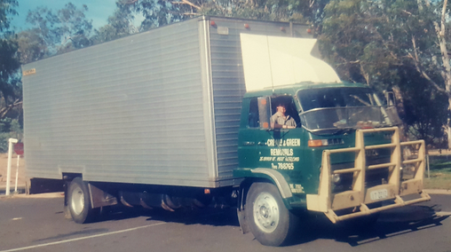 cream and green old truck.png