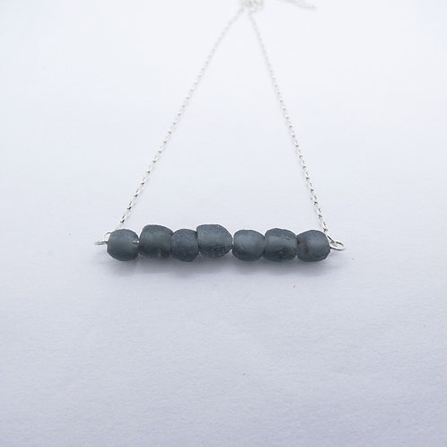 bidie kɔnmuadeɛ handmade recycled glass bead and recycled silver pendant