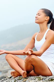woman_sitting_peacfully_on_rock