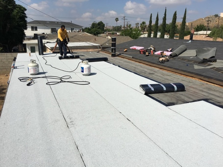 Flat roof torch down during