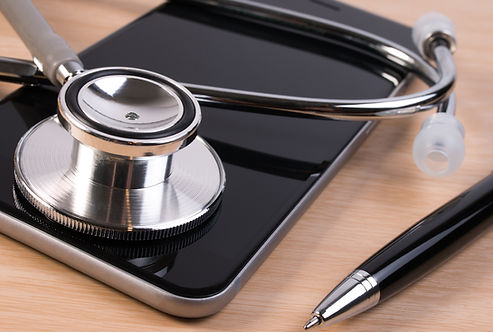 Stethoscope and pen on smartphone checki