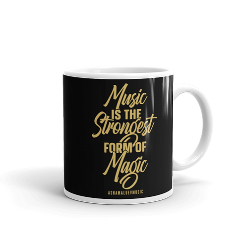 """Black glossy mug with a quote """"Music is the Strongest Form of Magic"""""""