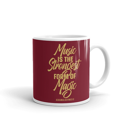 """Dark red glossy mug with a quote """"Music is the Strongest Form of Magic"""""""