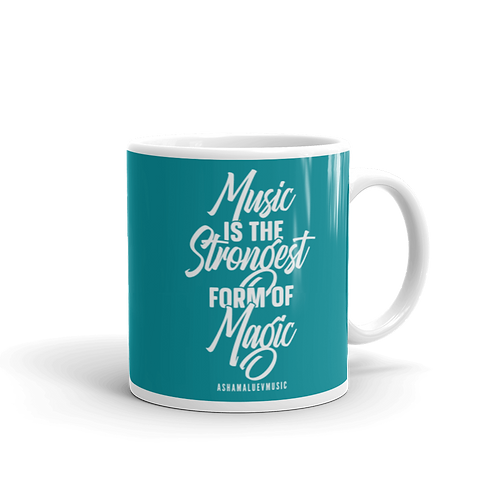 """Turquoise glossy mug with a quote """"Music is the Strongest Form of Magic"""""""