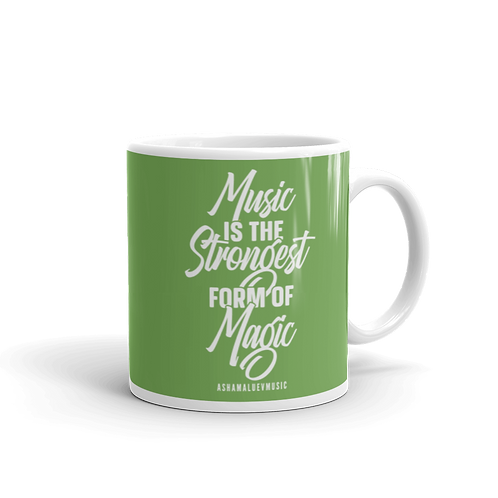 "Green glossy mug with a quote ""Music is the Strongest Form of Magic"""