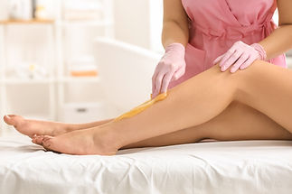 Woman having hair removal procedure on l