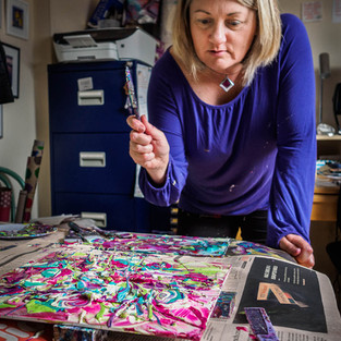 Artist Cherrie Mansfield creating a thrown painting