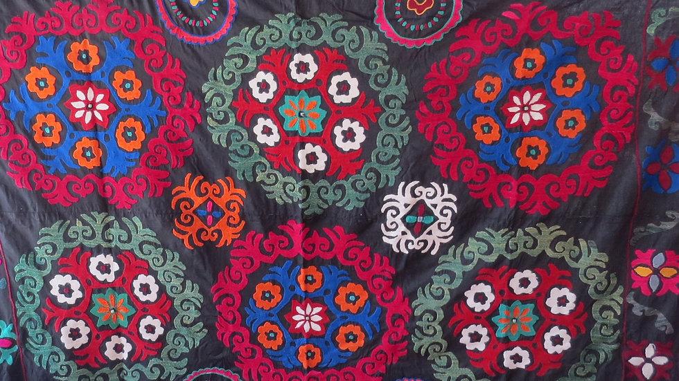 Black roundel suzani embroidery