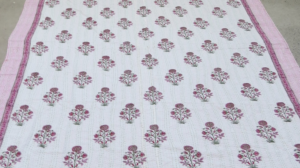 Quilt block printed with floral design and kantha stitching