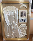 Wedding dress and wedding photos framed
