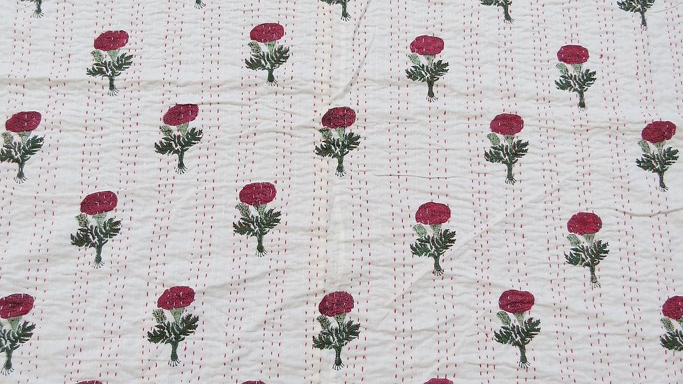 Quilt block printed with poppy design and kantha stitching