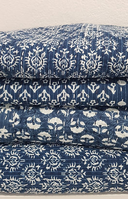 Quilt printed with blue and white  floral design and kantha stitchin