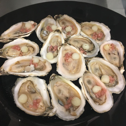 oyster with pickled potato pearl and classic mignonette sauce