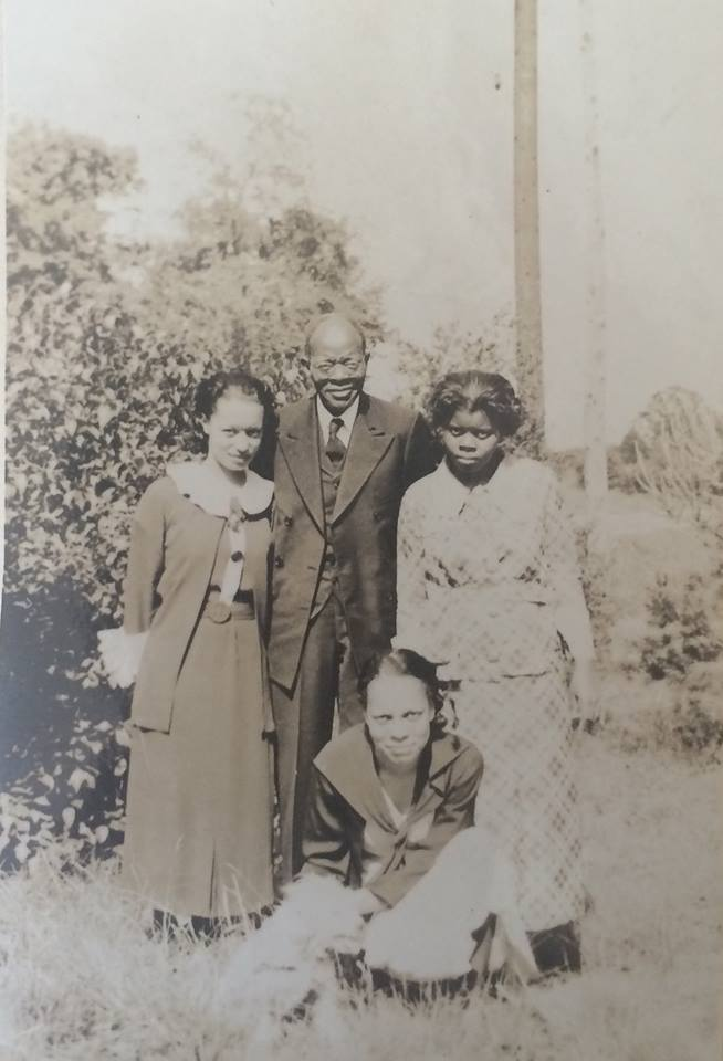 Rev. John Brice with (left to right) Florence Greene, Gladys Brown, and Carol Brice